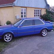 BMW 323i solgt