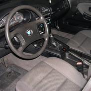 BMW 318i solgt