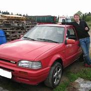 Mazda 323  solgt
