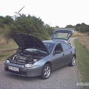 Mazda 323 F  Solgt.....