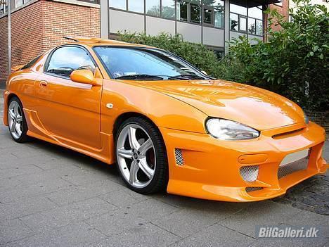 Mazda MX3 - solgt - billede af bilen med den gamle front billede 8