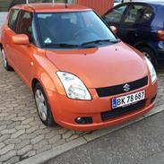 Suzuki Swift ( Madam Orange)